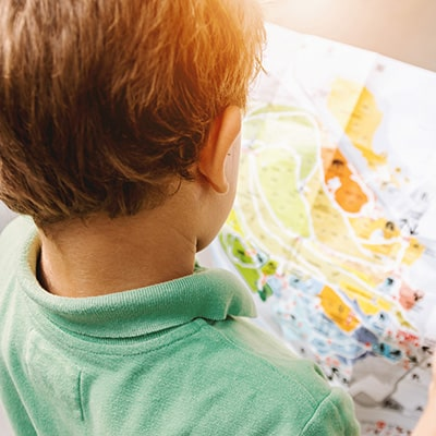 child-with-map-400x400